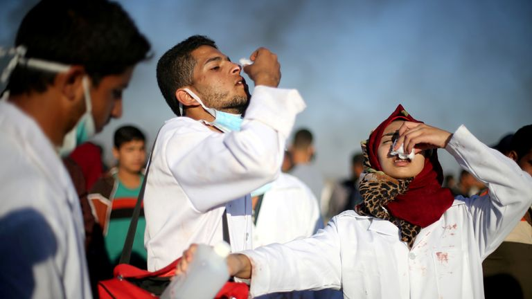 Razan Al-Najar, far right, working during a tear gas attack in Gaza in April