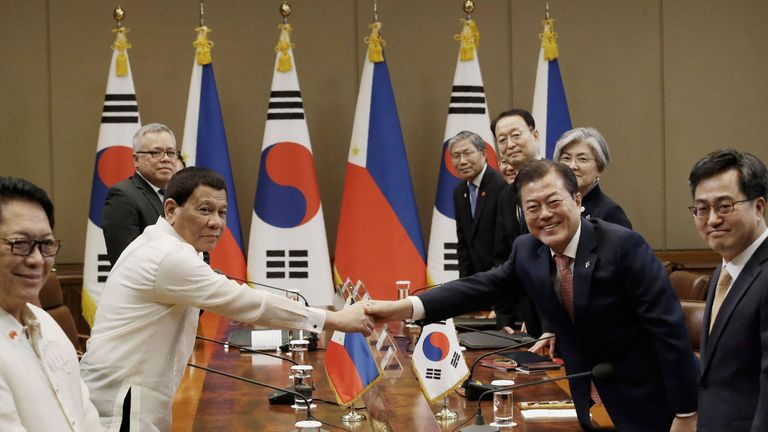 Mr Duterte shakes hands with South Korean president Moon Jae In