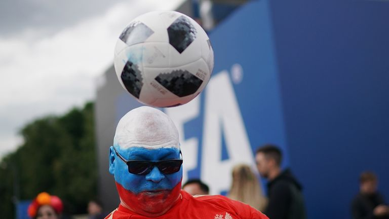 A Russian fan plays football at the official FIFA Fan Fest at Moscow State University