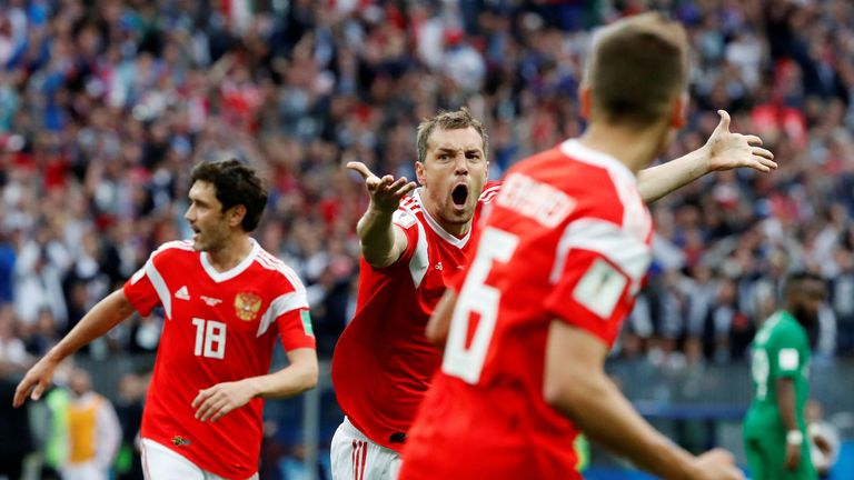 Artem Dzyuba celebrates scoring Russia's third goal