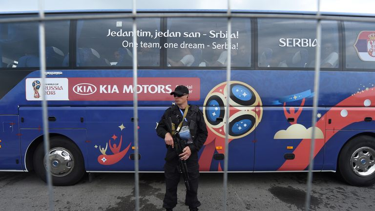 A Russian police officers stands guard as Serbia's national football team bus leave Hrabrovo airport in Kaliningrad on 11 June, 2018 ahead of the Russia 2018 World Cup. (Photo by ATTILA KISBENEDEK / AFP) (Photo credit should read ATTILA KISBENEDEK/AFP/Getty Images)