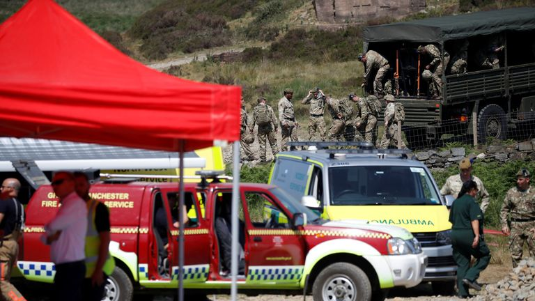 Members of the British Army prepare to help firefighters as they continue tackling a blaze on Saddleworth..
