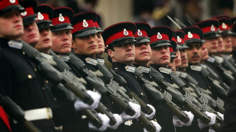 Cadets take part in the Sovereign's Parade in heavy rain at the Royal Military Academy at Sandhurst on December 14, 2012 in England