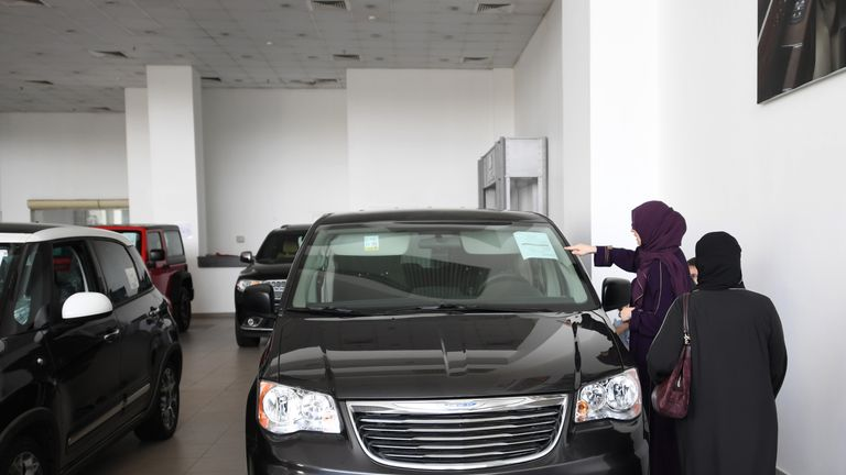 Saudi women examine cars at a showroom in the Red Sea resort of Jeddah on June 23, 2018, a day before the lifting of a ban on women driving in the conservative Arab kingdom
