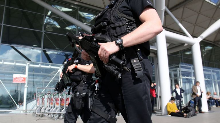 Armed Police officers patrol outside the terminal building at London Stansted airport in Essex. PRESS ASSOCIATION Photo. Picture dateTuesday March 22 2016. Photo credit should read Chris Radburn/PA
