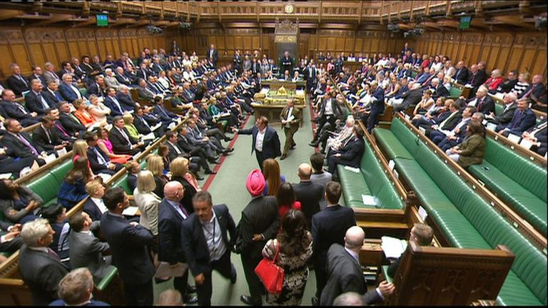 SNP MPs gesture to the Tory benches as they leave the chamber