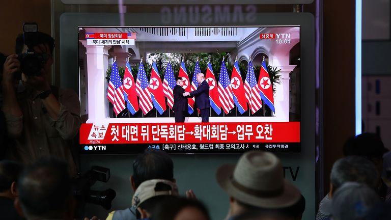 South Koreans watch Donald Trump and Kim Jong Un shake hands