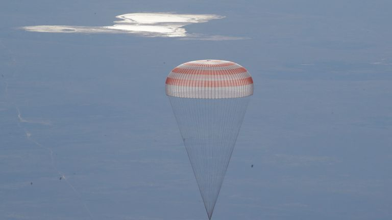 A Russian Soyuz MS-07 space capsule descends about 150km (90 miles) south-east of the Kazakh town of Dzhezkazgan