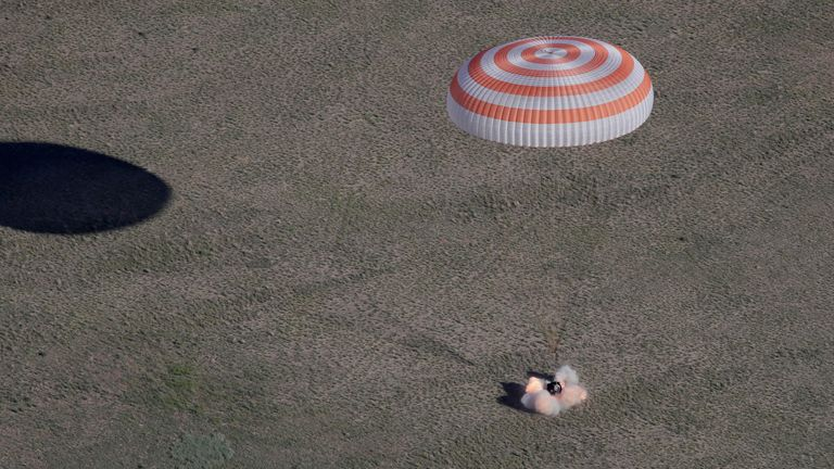 A capsule with Anton Shkaplerov, Scott Tingle and Norishige Kanai, lands on the steppes of Kazakhstan