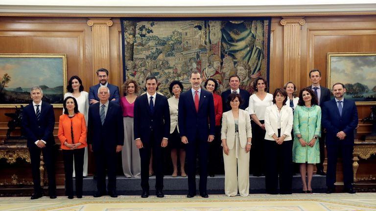 Spain's new cabinet members stand with King Felipe during a swearing-in ceremony at the Zarzuela Palace outside Madrid