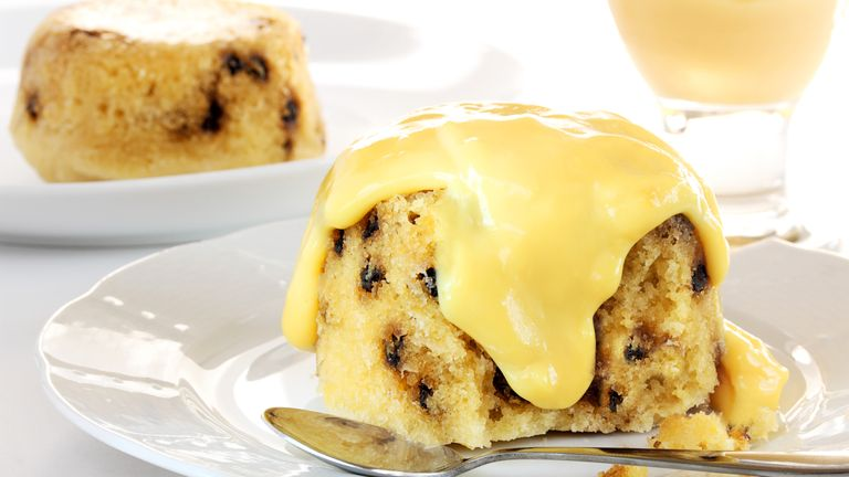 Spotted dick with custard - Stock image Custard, Cake, England, Black Currant, Currant