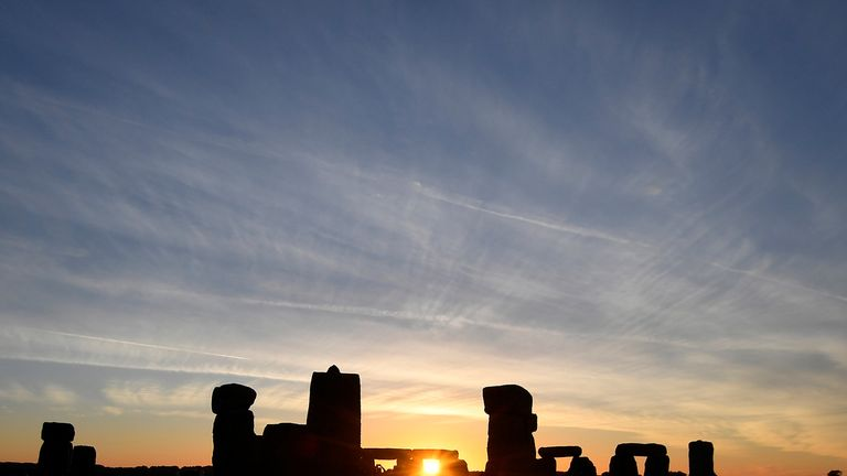 Revellers welcome in the Summer Solstice at Stonehenge stone circle in southwest Britain