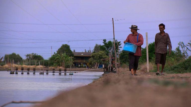 Prasit Choothip and Somnuak Jeenklab run a shrimp farm next to the illegal Bangkok factory