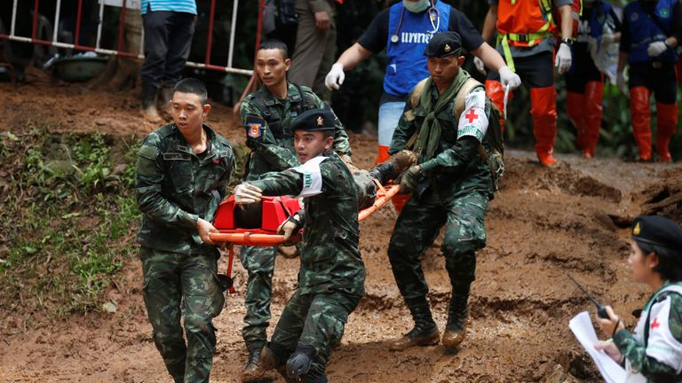 Soldiers and rescue workers carry out a simulated victim during a drill