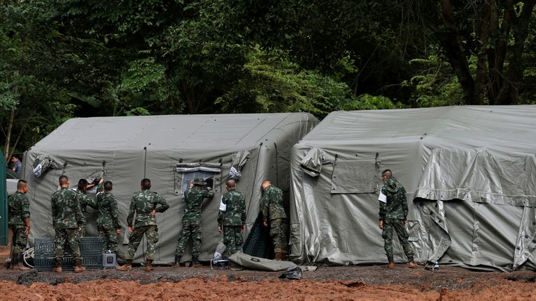 Soldiers have prepared a makeshift hospital near the cave