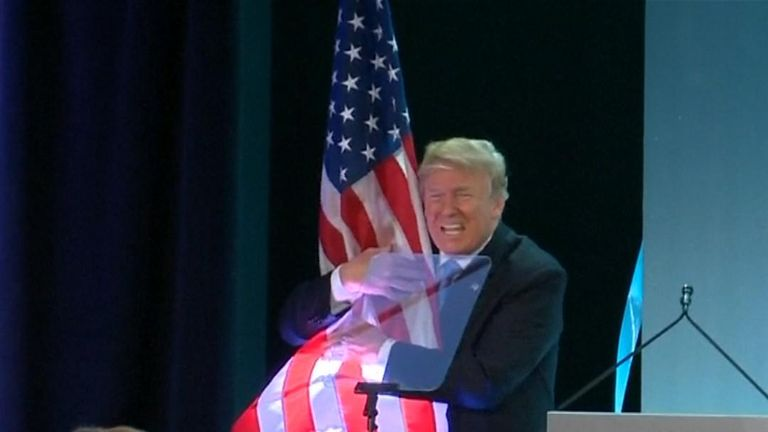 Trump gives big 'America First' bear hug to U.S. flag
