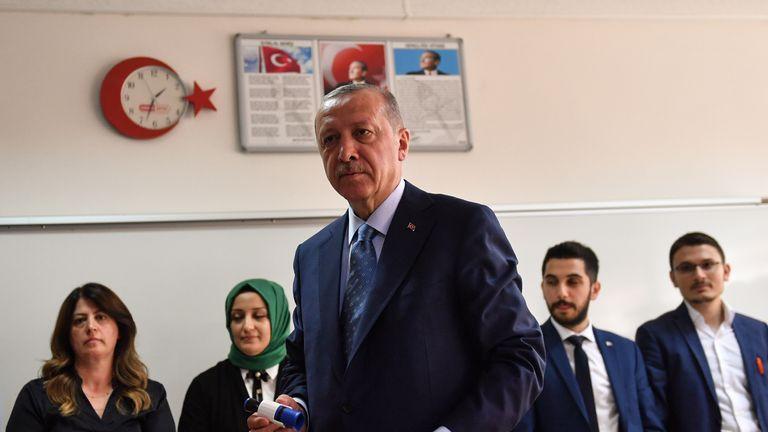 Recep Tayyip Erdogan casting his vote