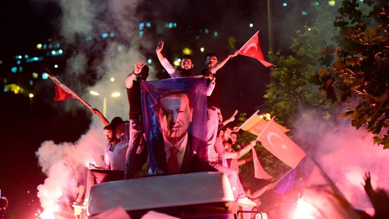 Supporters of Recep Tayyip Erdogan's AK party waving flags in Istanbul
