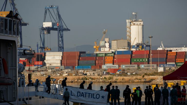 Migrants disembarking from Italian coast guard vessel Dattilo in Valencia