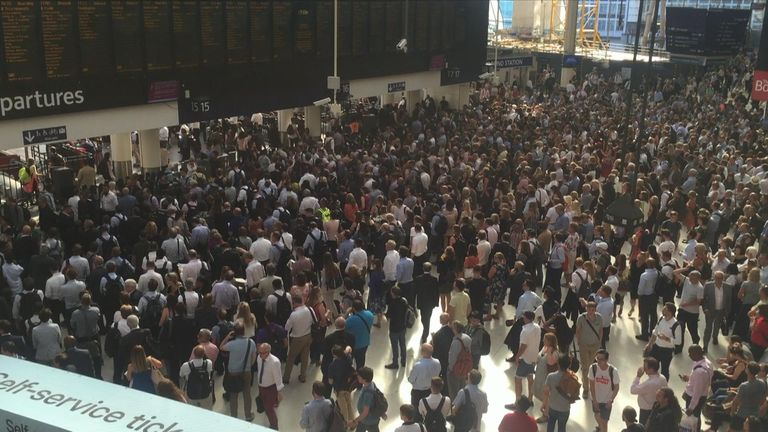 Crowds of commuters waiting for a train at London Waterloo