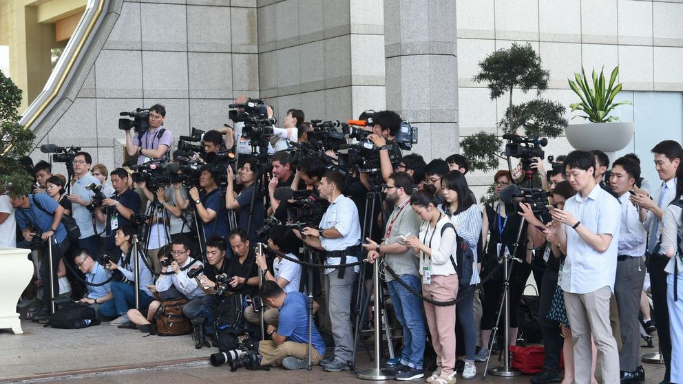 Members of the media wait for North Korea delegation to leave after talks with US counterparts in Singapore on June 11 2018, ahead of Kim Jong Un/ Donald Trump summit