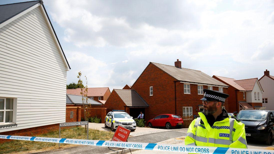 Police guard entrance to housing estate on Muggleton Road, Amesbury