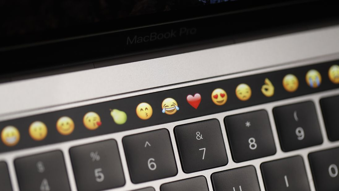 CUPERTINO, CA - OCTOBER 27: Emoticons are displayed on the Touch Bar on a new Apple MacBook Pro laptop during a product launch event on October 27, 2016 in Cupertino, California. Apple Inc. unveiled the latest iterations of its MacBook Pro line of laptops and TV app. (Photo by Stephen Lam/Getty Images)