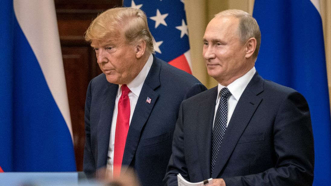 HELSINKI, FINLAND - JULY 16:  U.S. President Donald Trump (L) and Russian President Vladimir Putin arrive to waiting media during a joint press conference after their summit on July 16, 2018 in Helsinki, Finland. The two leaders met one-on-one and discussed a range of issues including the 2016 U.S Election collusion.  (Photo by Chris McGrath/Getty Images) *** Local Caption *** Donald Trump: Vladimir Putin