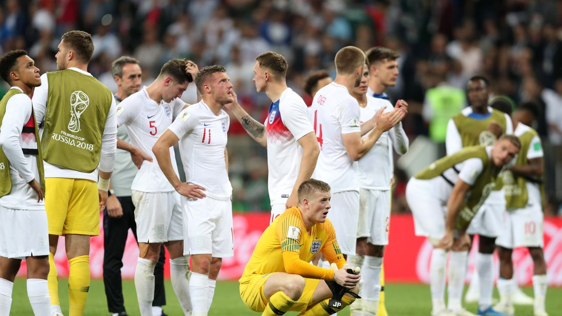 Dejected England fans after their semi-final loss