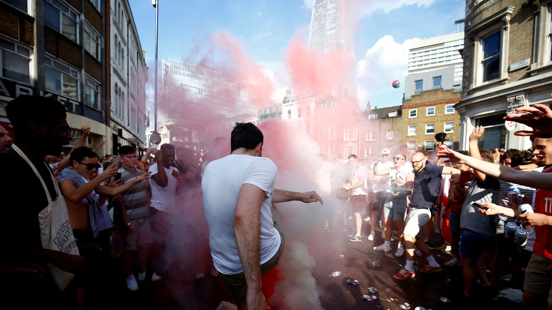 England fans set off smoke bombs after the match