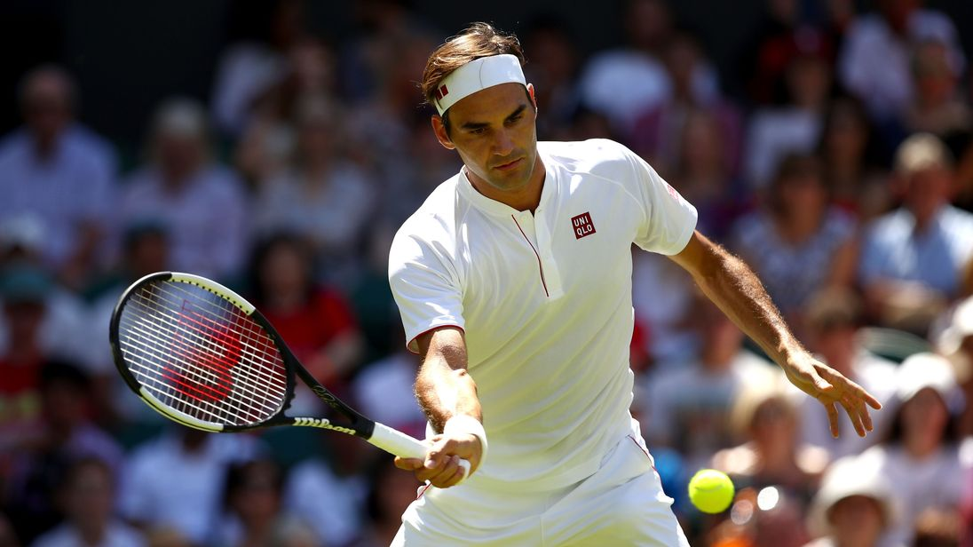 Federer donning his new Uniqlo branded tennis gear
