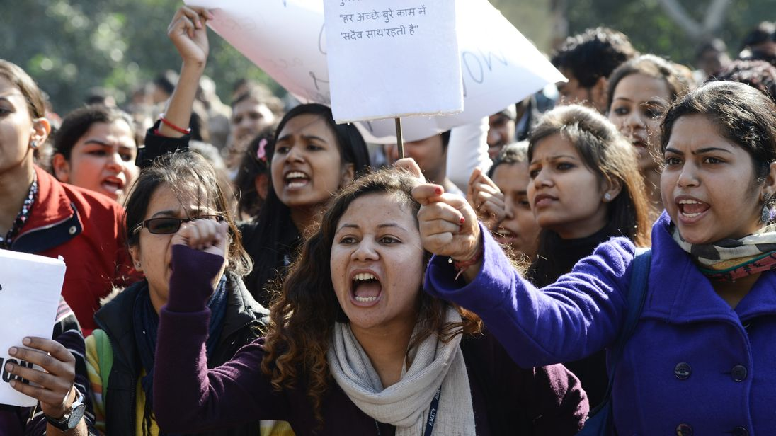 Indian activists shout slogans outside police headquarters during a protest in New Delhi following the gang-rape of Jyoti Singh
