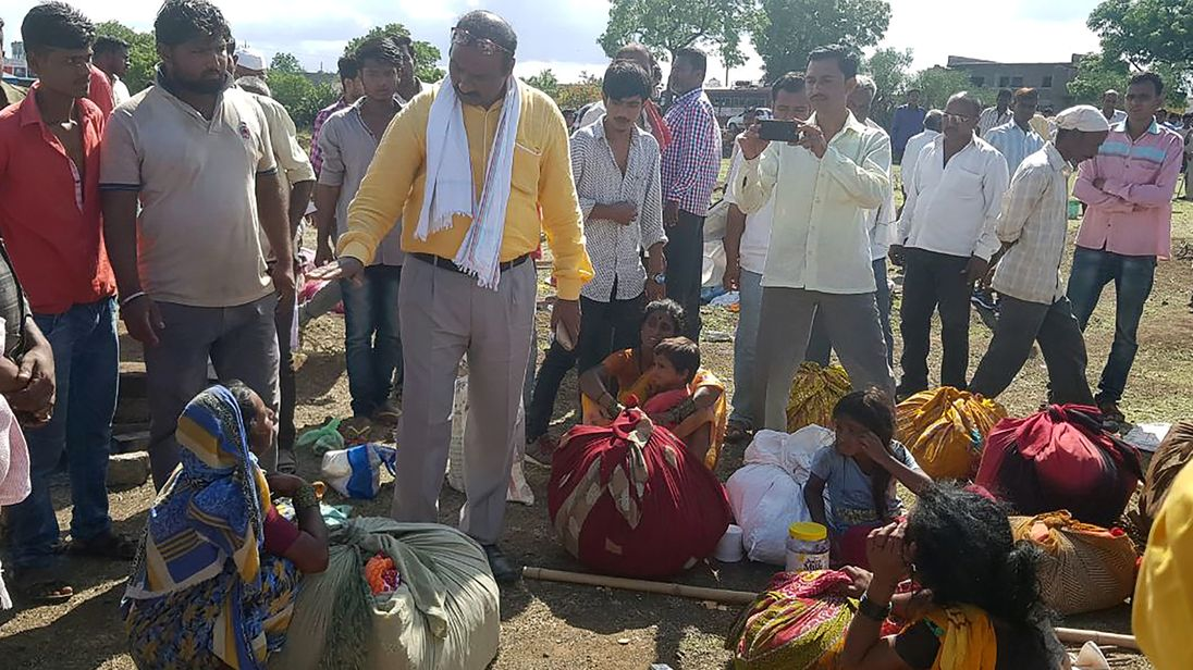 Indian village leaders speak to the relatives of men killed in a lynching incident in Dhule district on 1 July