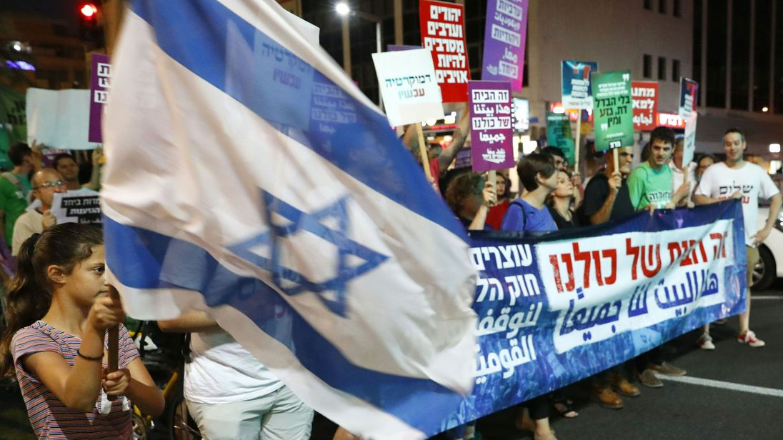 Demonstrators attend a rally to protest against the Jewish Nation-State Bill