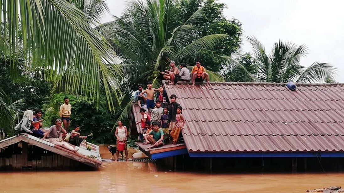Villagers evacuate after the Xepian-Xe Nam Noy hydropower dam collapsed in Laos