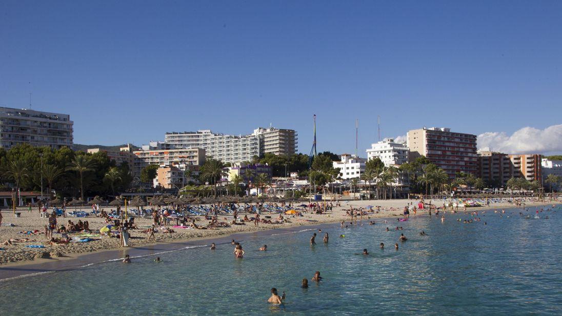Tourists swim and sunbath at Magaluf's beach in Calvia on Mallorca Island on August 10, 2015. AFP PHOTO/ JAIME REINA (Photo credit should read JAIME REINA/AFP/Getty Images)