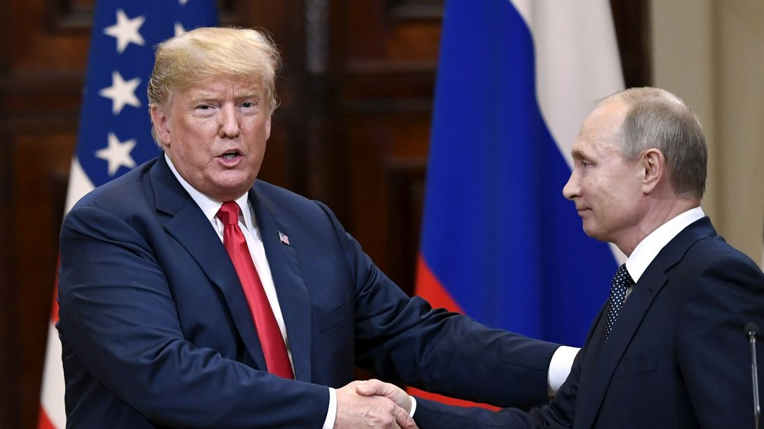 U.S. President Donald Trump and Russia's President Vladimir Putin shake hands after their joint news conference in the Presidential Palace in Helsinki, Finland