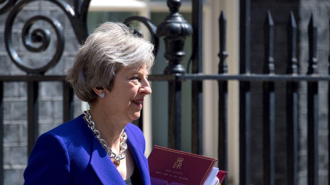 Theresa May leaves Downing Street in Westminster to attend Prime Minister's Questions at the Commons