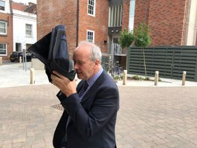 Dr David Crichton leaving Winchester Crown Court during his trial