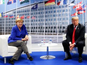 Donald Trump and Angela Merkel attend a bilateral meeting during the NATO summit