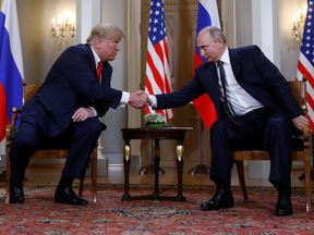 US President Donald Trump and Russia's leaer Vladimir Putin shake hands