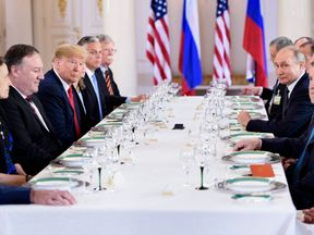 US President Donald Trump (3L), Russia's President Vladimir Putin (2R) and others wait for a working lunch meeting at Finland's Presidential Palace on July 16, 2018 in Helsinki, Finland. - The US and Russian leaders opened an historic summit in Helsinki, with Donald Trump promising an 'extraordinary relationship' and Vladimir Putin saying it was high time to thrash out disputes around the world. (Photo by Brendan Smialowski / AFP) (Photo credit should read BRENDAN SMIALOWSKI/AFP/Getty Images)