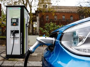 A Go Ultra Low Kia Soul EV on charge on a London street