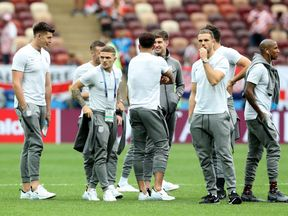 England players take part in a pitch inspection ahead of the match in Moscow