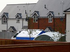 Forensic tents at the back of a housing estate in Amesbury