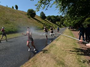Runners in Scotland cool off during the Iron Man triathlon
