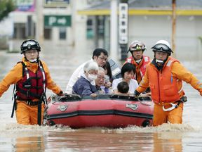 Residents are rescued from a flooded area at a hospital in Kurashiki, Okayama