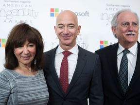 Amazon CEO Jeff Bezos poses on the red carpet with his parents Mike and Jackie, for the Smithsonian Magazine's 2016 American Ingenuity Awards