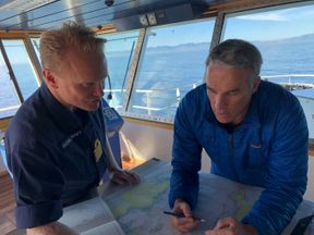 Lewis Pugh studies the map with Royal Navy captain Matt Syrett