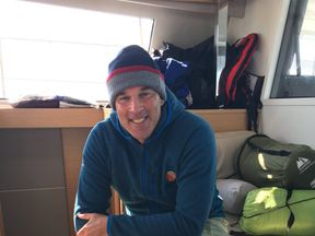 Lewis warms up on the support boat after four miles